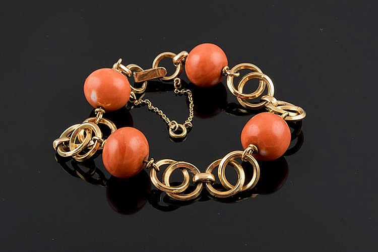 A GOLD AND CORAL BRACELET