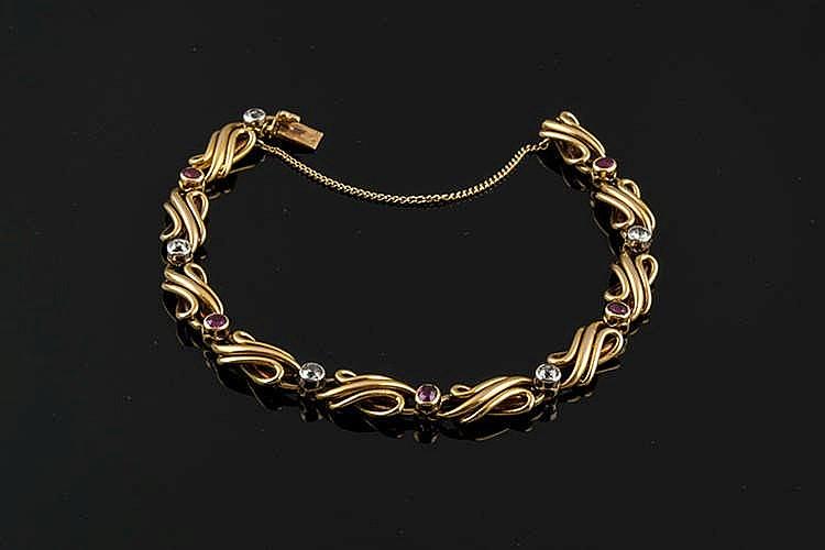 A GOLD, RUBY AND DIAMOND BRACELET