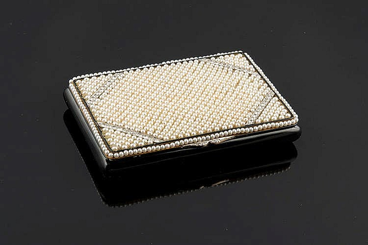 A GOLD VANITY CASE