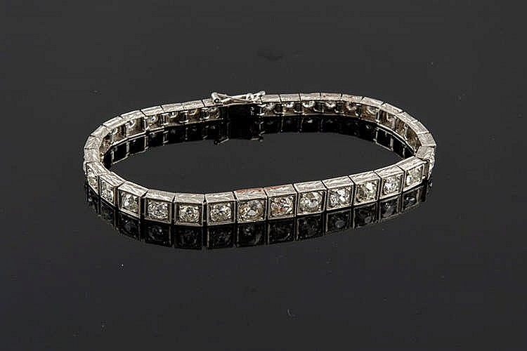 A PLATINUM AND DIAMOND BRACELET