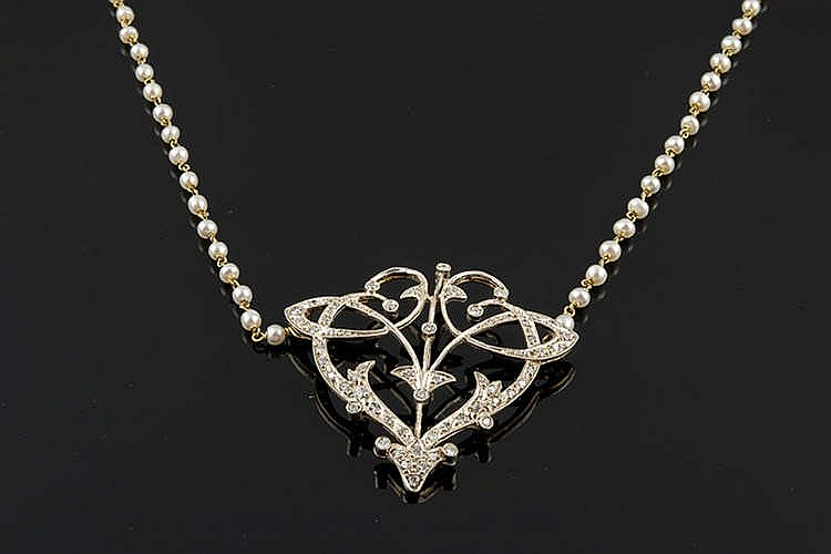 A GOLD, SILVER, PEARL AND DIAMOND NECKLACE