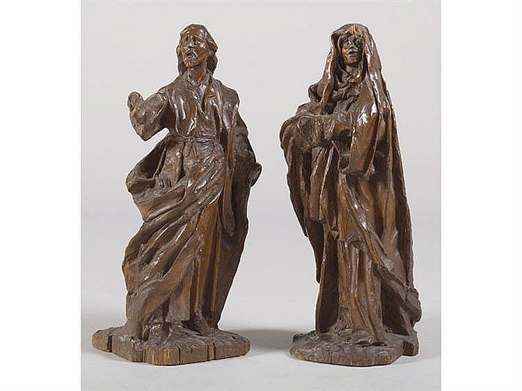 A PAIR OF CARVED WALNUT FIGURES