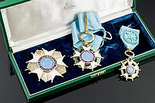 A SET OF GILT SILVER AND ENAMEL MEDALS