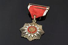 A GILT SILVER AND ENAMEL COMMEMORATIVE MEDAL