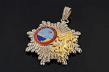 A GILT SILVER, SILVERED METAL AND ENAMEL COMMEMORATIVE MEDAL
