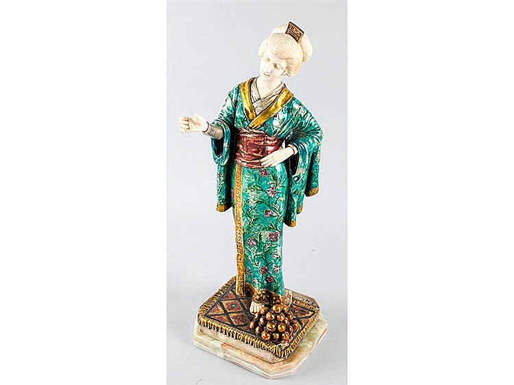 A CHRYSELEPHANTINE JAPANESE FIGURE