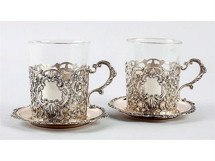 A PAIR OF GLASSES WITH SILVER GLASS HOLDERS