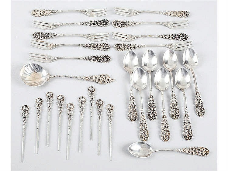 A SILVER FLATWARE AND CUTLERY SET