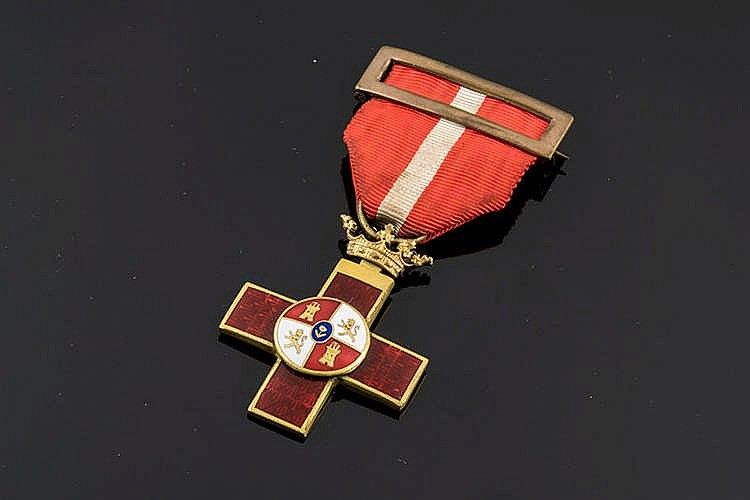 A GILT METAL AND ENAMEL MEDAL