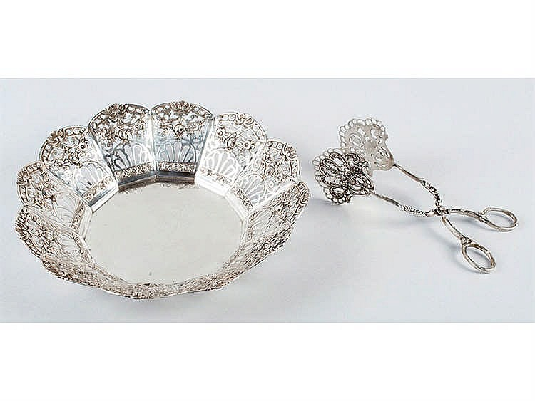 A SILVER BREAD-BASKET WITH SERVING TONGS