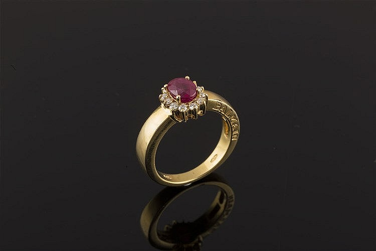 A GOLD, RUBY AND DIAMOND RING, BY BALMAIN