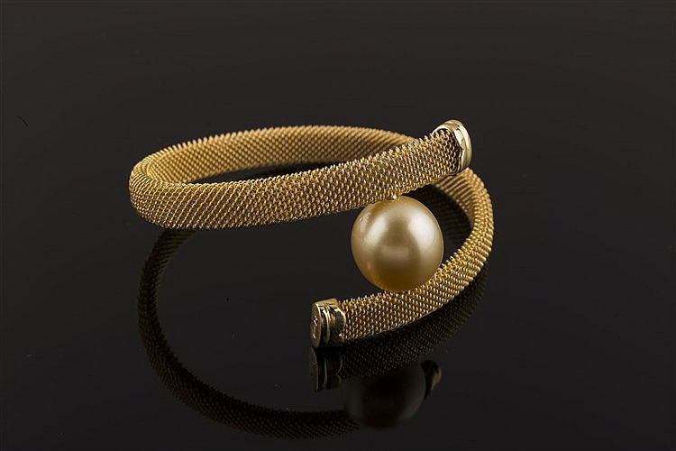 A PEARL, GILT STEEL AND GILT STERLING SILVER BRACELET