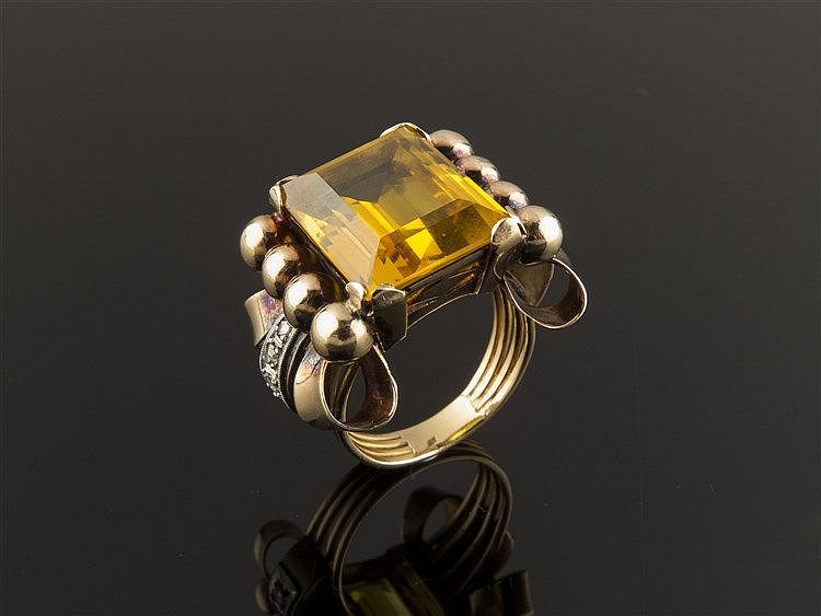 A GOLD, synthetic corundum AND DIAMOND RING