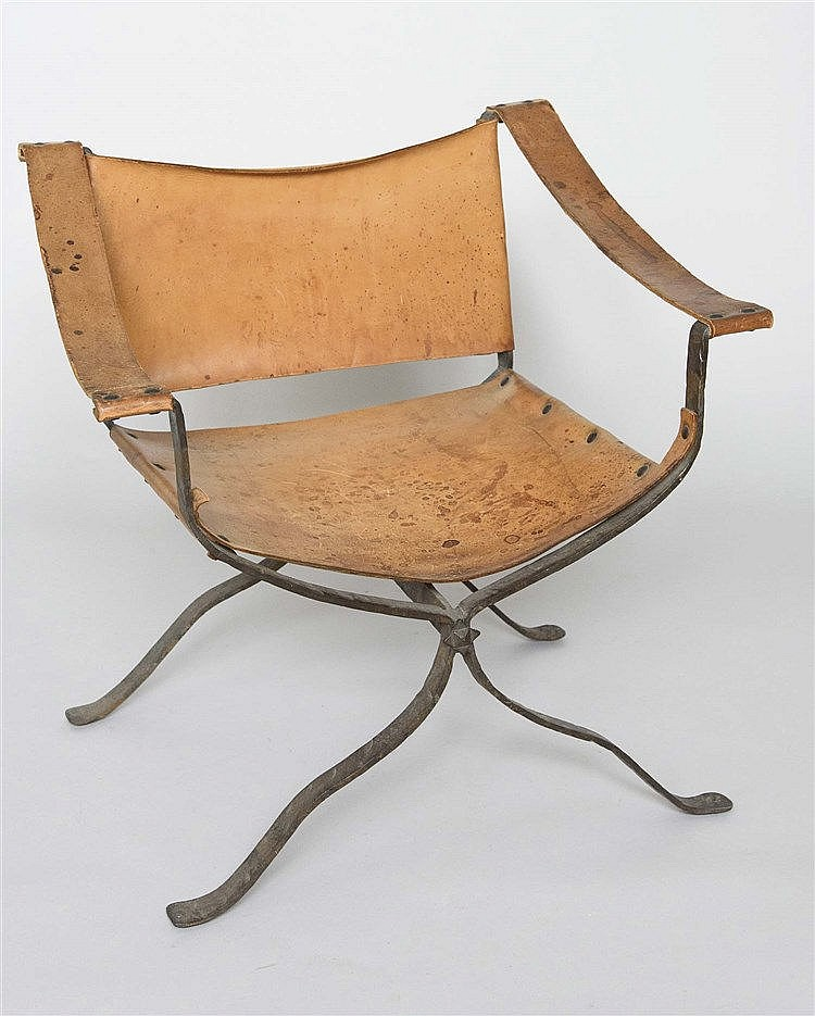 AN IRON AND LEATHER ARMCHAIR, CIRCA 1970