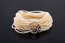 A GOLD, DIAMOND AND PEARL CHOKER