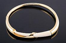 A GOLD AND IVORY CHOKER