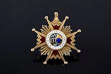 A GOLD AND ENAMEL STAR BADGE