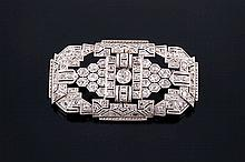 AN ART DECO GOLD AND DIAMOND BROOCH