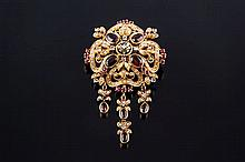A GOLD, RUBY, GARNET, PEARL AND DIAMOND BROOCH