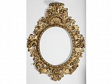 A SPANISH BAROQUE-STYLE CARVED GILTWOOD FRAME