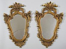 A PAIR OF CARVED GILTWOOD WALL MIRRORS