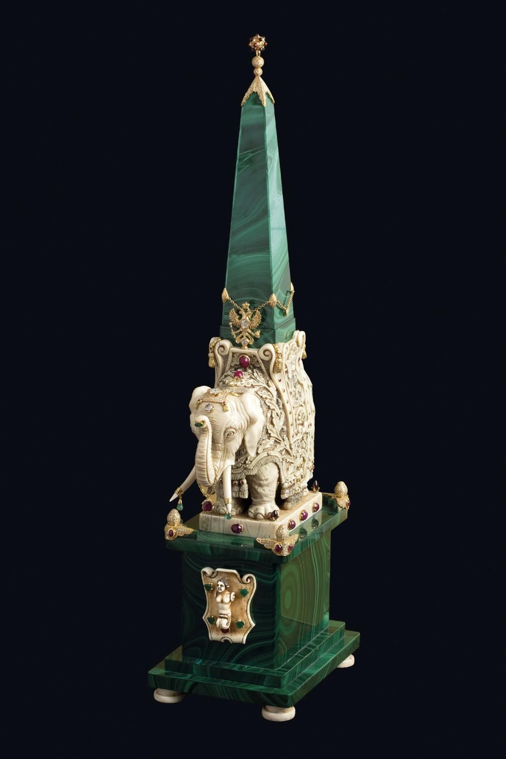 A CARVED IVORY AND MALACHITE SCULPTURE