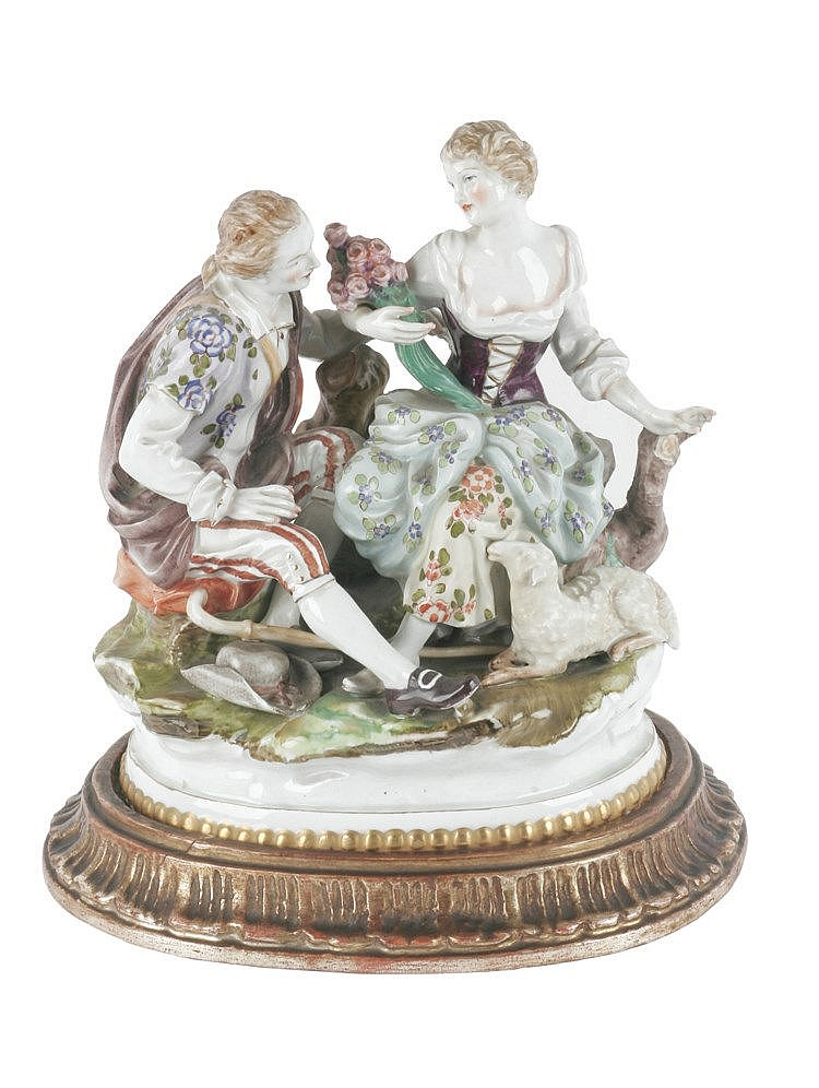 EARLY 20th CENTURY PORCELAIN GROUP OF FIGURINES
