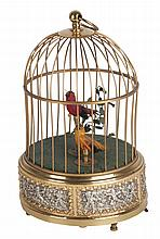 20th CENTURY GILT BRASS AUTOMATON MODELLED WITH BIRDS IN A CAGE