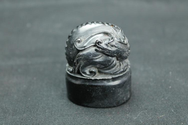 A Black Soapstone Seal