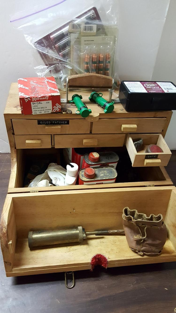 Wood box with black powder accessories