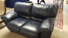 Dark blue leather style love seat