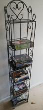Metal rack with DVDs and VHS tapes
