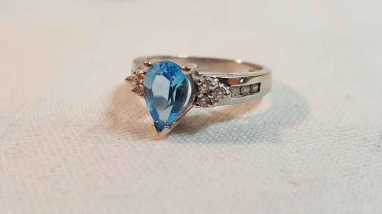 14k wht. gold Blue Topaz & Diamond ladies ring