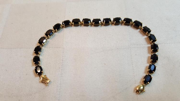 14k yel gold Natural Dk. Blue Sapphire bracelet