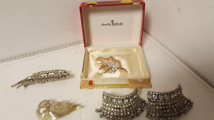 Lot of signed costume jewelry, Trifari, etc