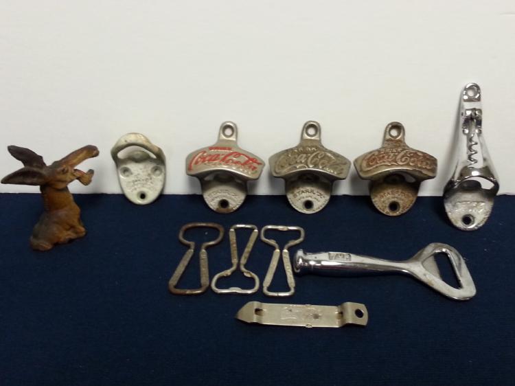 11 vintage Coca-Cola metal bottle openers