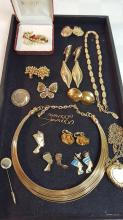 Lot of gold tone costume jewelry, necks, ears