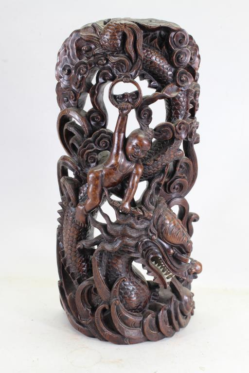 ELABORATELY CARVED CHILD ON DRAGON CHINESE CARVING
