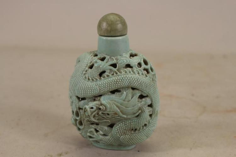CHINESE PORCELAIN MOLDED 'DRAGON' SNUFF BOTTLE