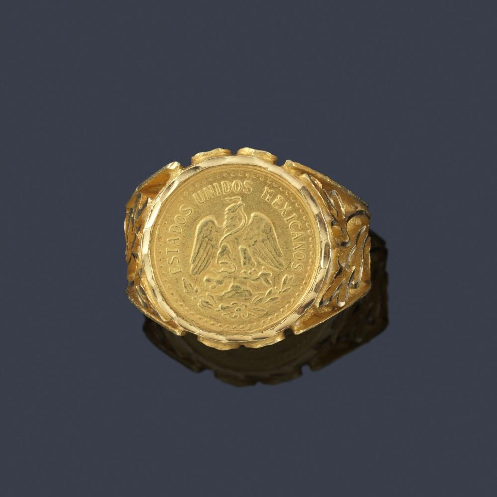 Signet ring with a coin on the front with plant mo…