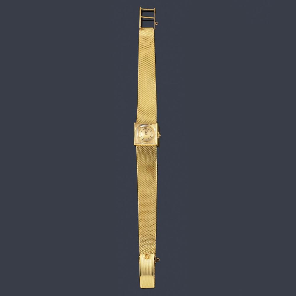 OMEGA for women with 18K yellow gold case and brac…
