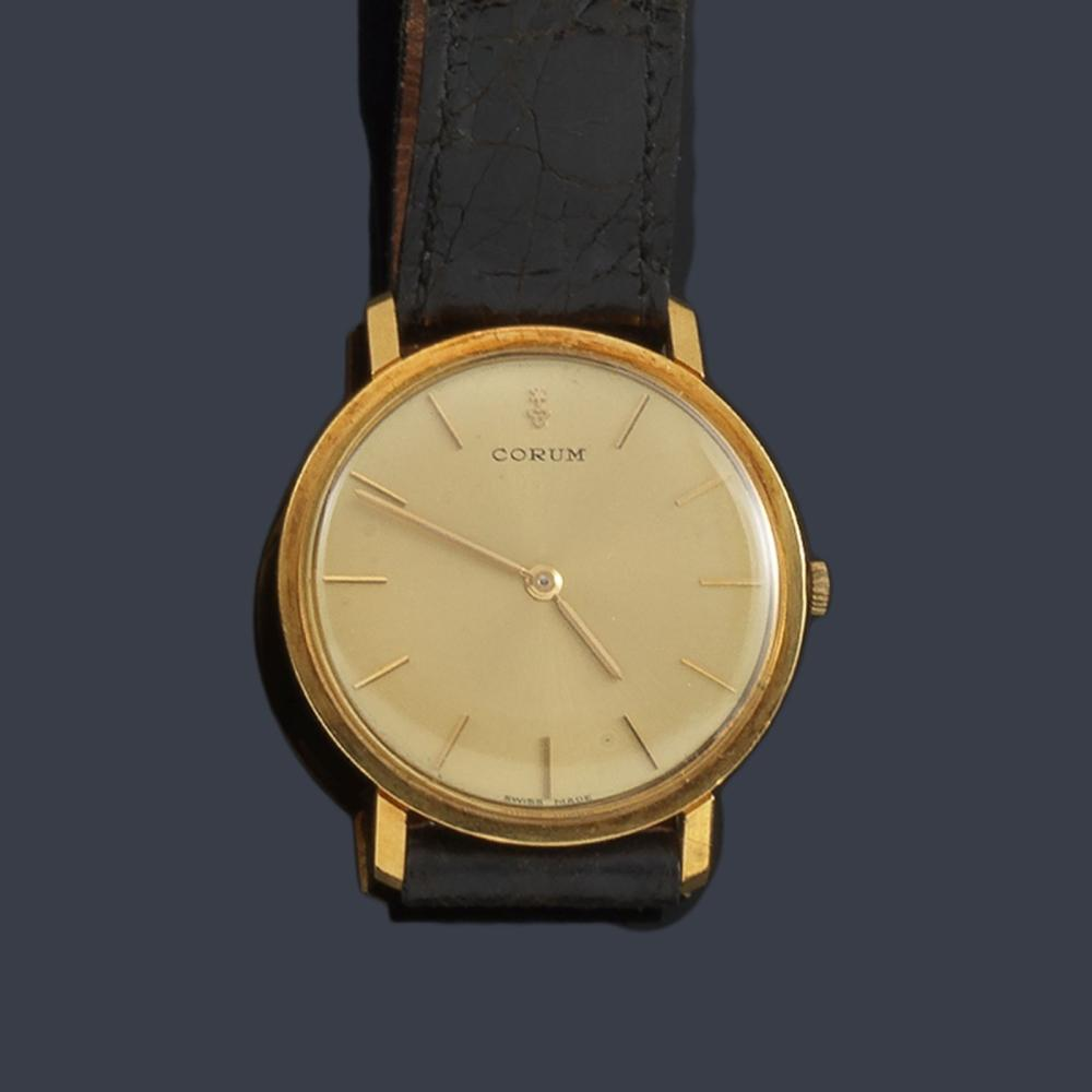 CORUM for men with 18K yellow gold case. …