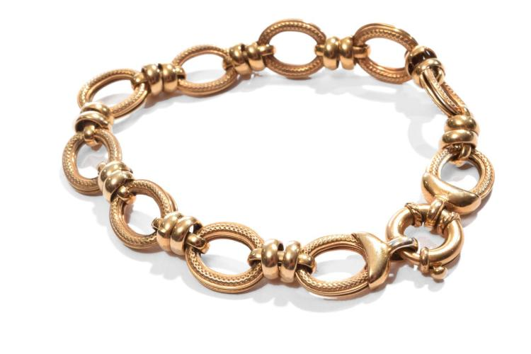 GOLD LINK BRACELET IN THE MANNER OF ELIZABETH LOCKE.