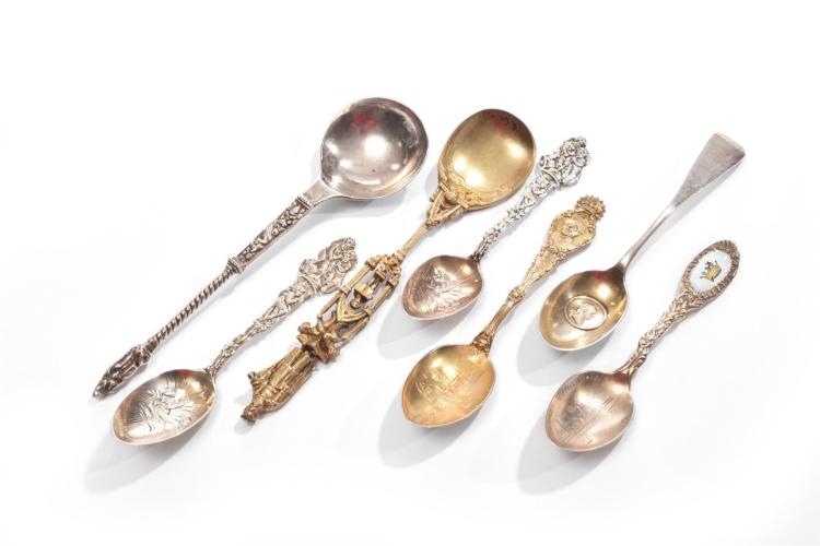SEVEN SILVER FIGURAL SPOONS.