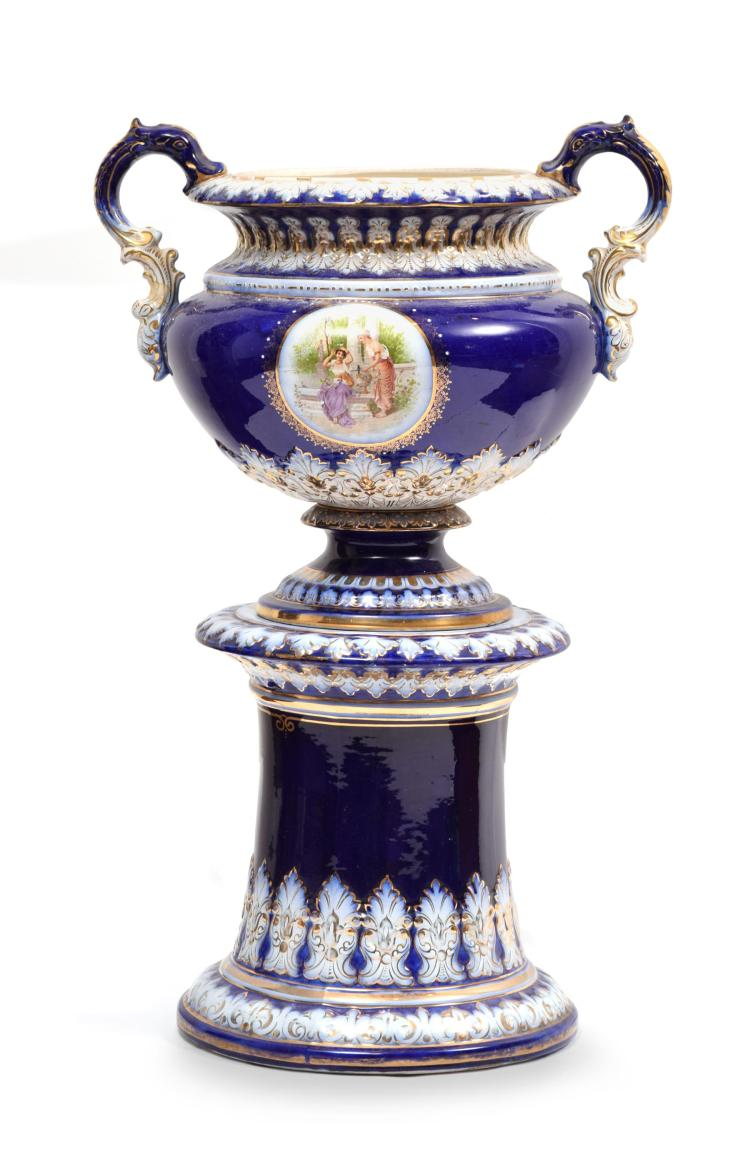 WHEELING POTTERY JARDINIERE ON PEDESTAL.