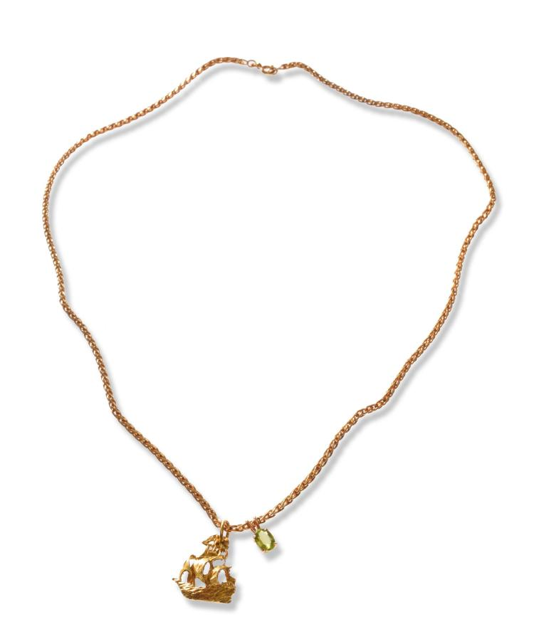 AN 18K SHIP PENDANT AND NECKLACE.
