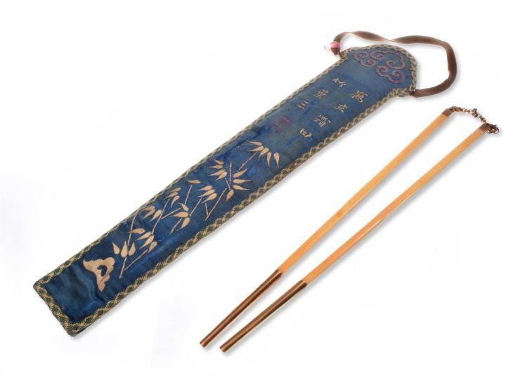 A PAIR OF BEIPING FENG XIANG BONE AND 22K GOLD CHOPSTICKS IN TOURMALINE BEADED KESI FAN CASE.