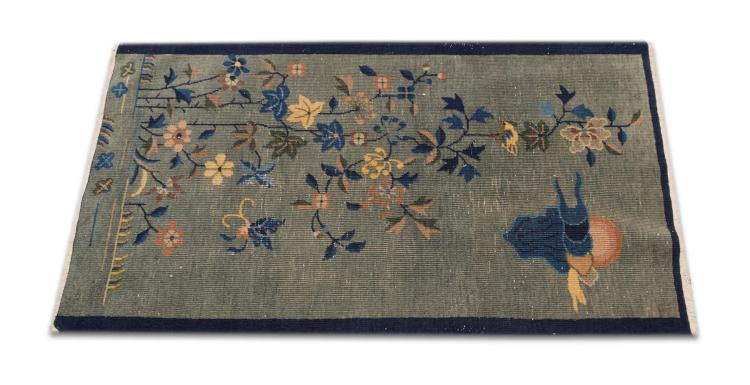 HAND WOVEN DIRECTIONAL THROW RUG.