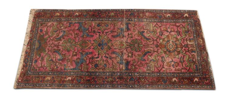 HAND WOVEN AREA RUG.