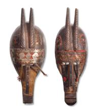 PAIR OF TRIBAL AFRICAN MASKS.